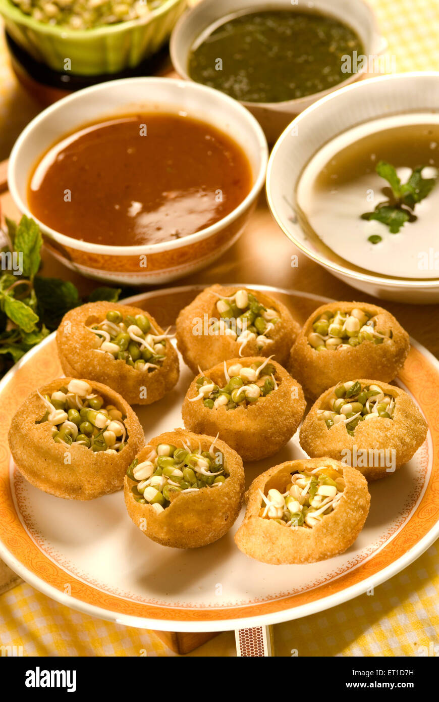 Snacks ; pani puri with sprouted mung served in plate with chutney - Stock Image
