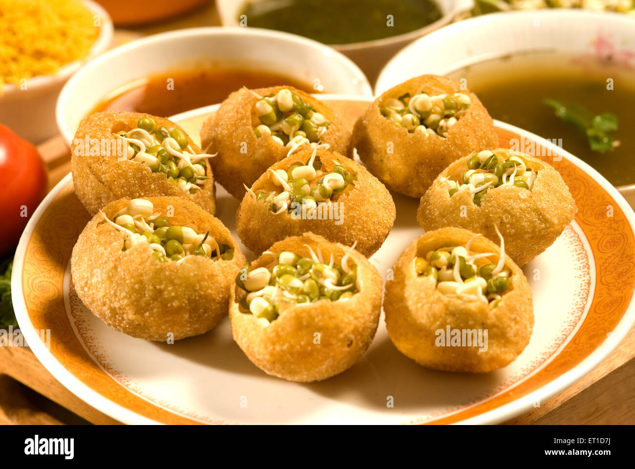 Snacks ; pani puri decorated with sprouted mung served in plate - Stock Image
