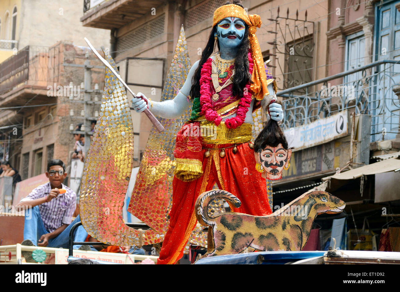 A man in disguise of some avtar in procession of Ramnavami Jodhpur Rajasthan India no mr - Stock Image