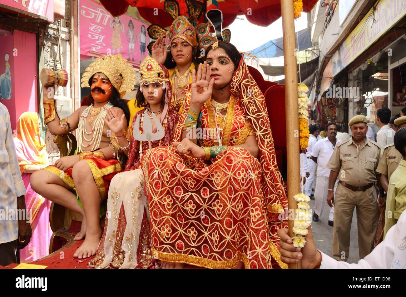 Girls in disguise of jain mythological characters in procession of Mahavir Jayanti Jodhpur Rajasthan India NO MR - Stock Image