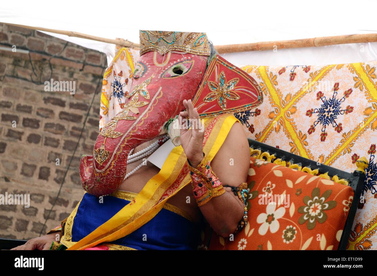 A man in disguise of Ganesh Ji in  religious procession of Pipa Jayanti Jodhpur Rajasthan India - Stock Image