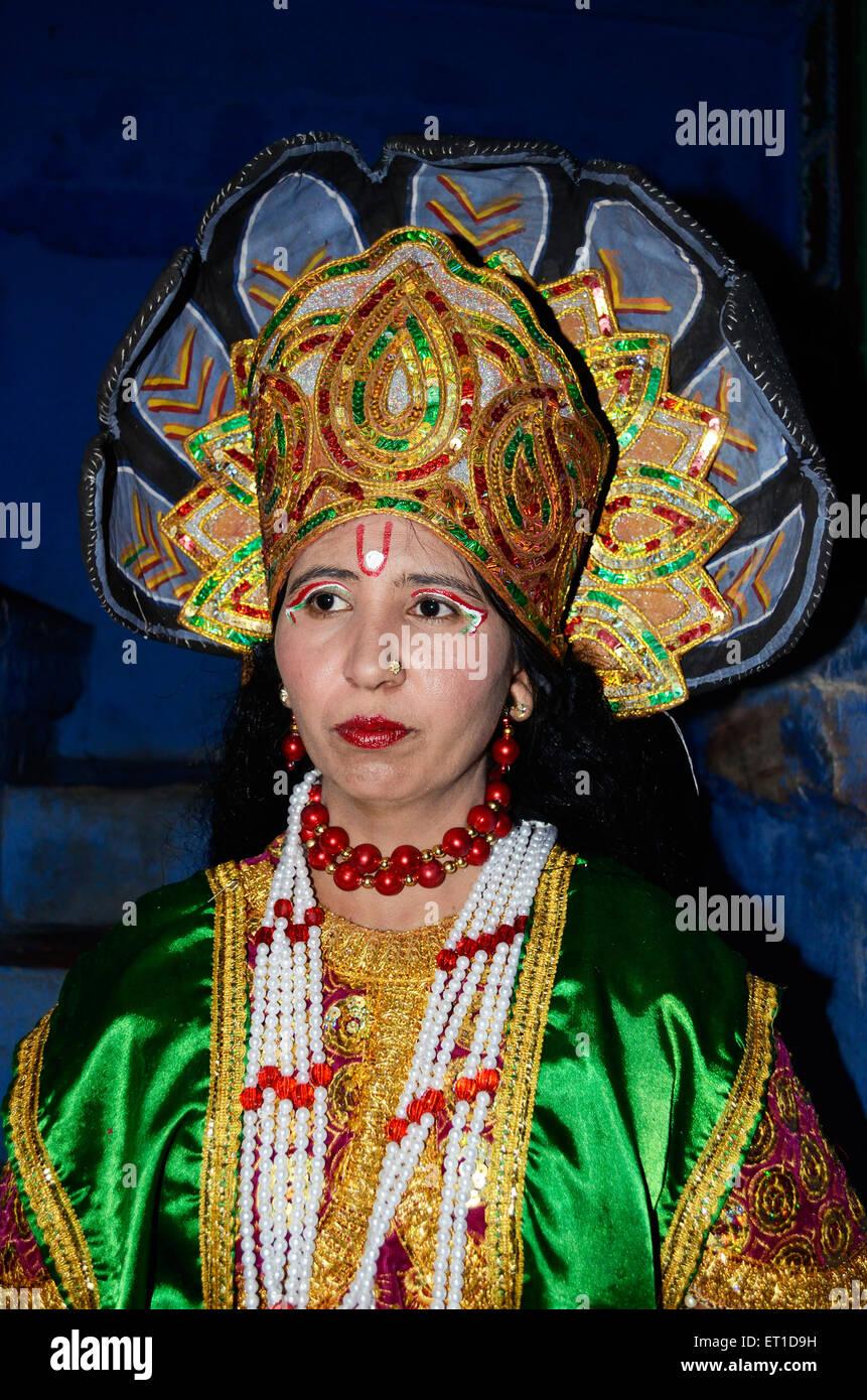 A woman in disguise of Vishnu  on occasion of Dheenga Gavar festival Jodhpur Rajasthan India NO MR - Stock Image