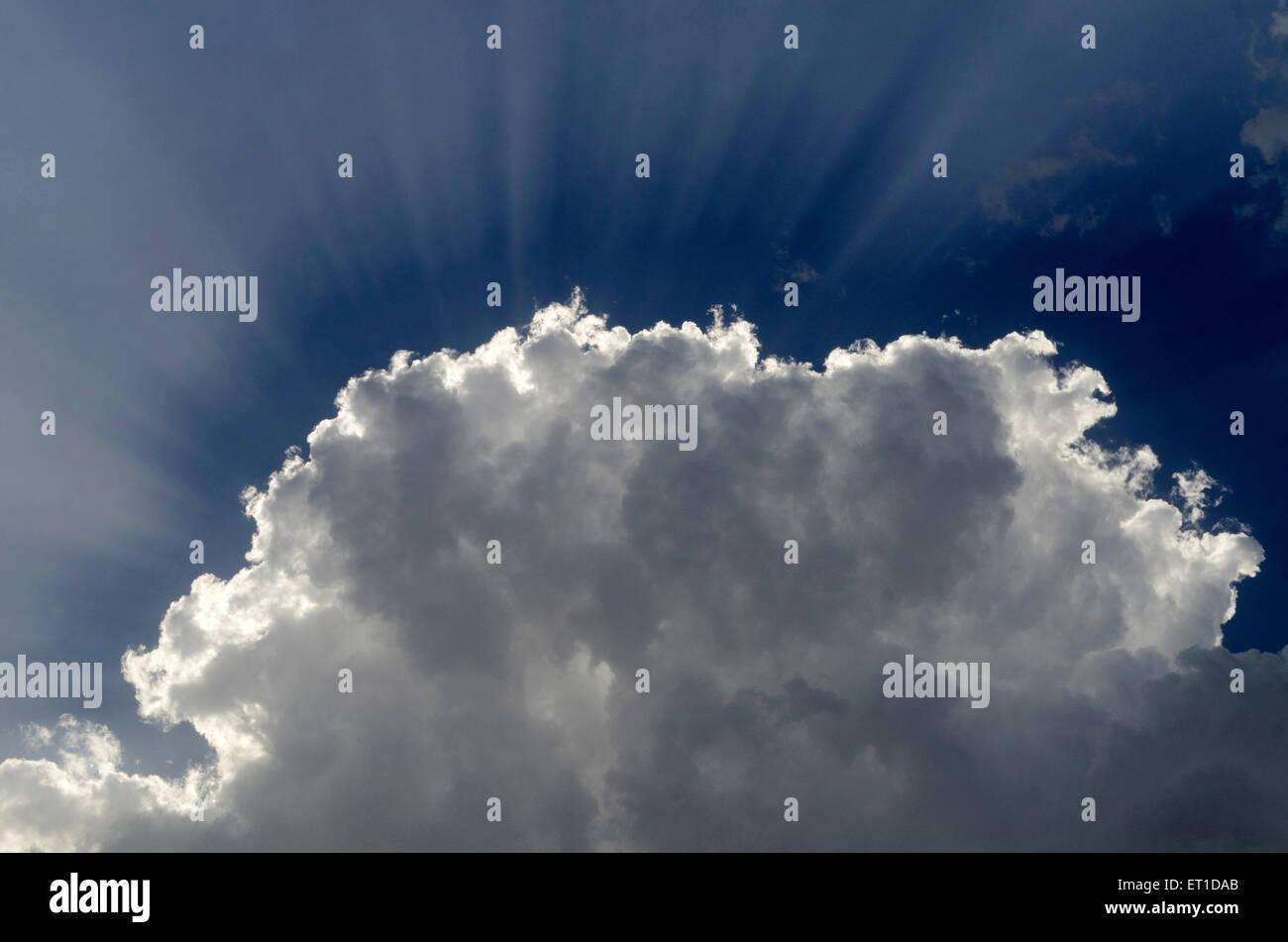 Sunrays behind white cloud in moon light Jaipur Rajasthan India - Stock Image
