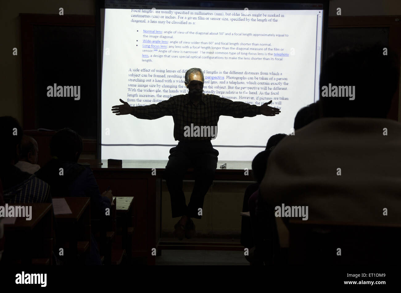 Teacher teaching 180 degree angle in Photography at Jaipur Rajasthan India MR#704 - Stock Image