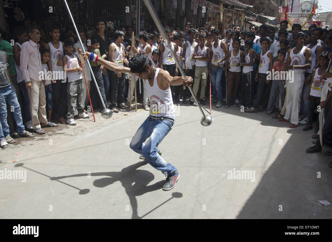 boy performing acrobatics in Ram navmi procession in Jodhpur at Rajasthan India - Stock Image