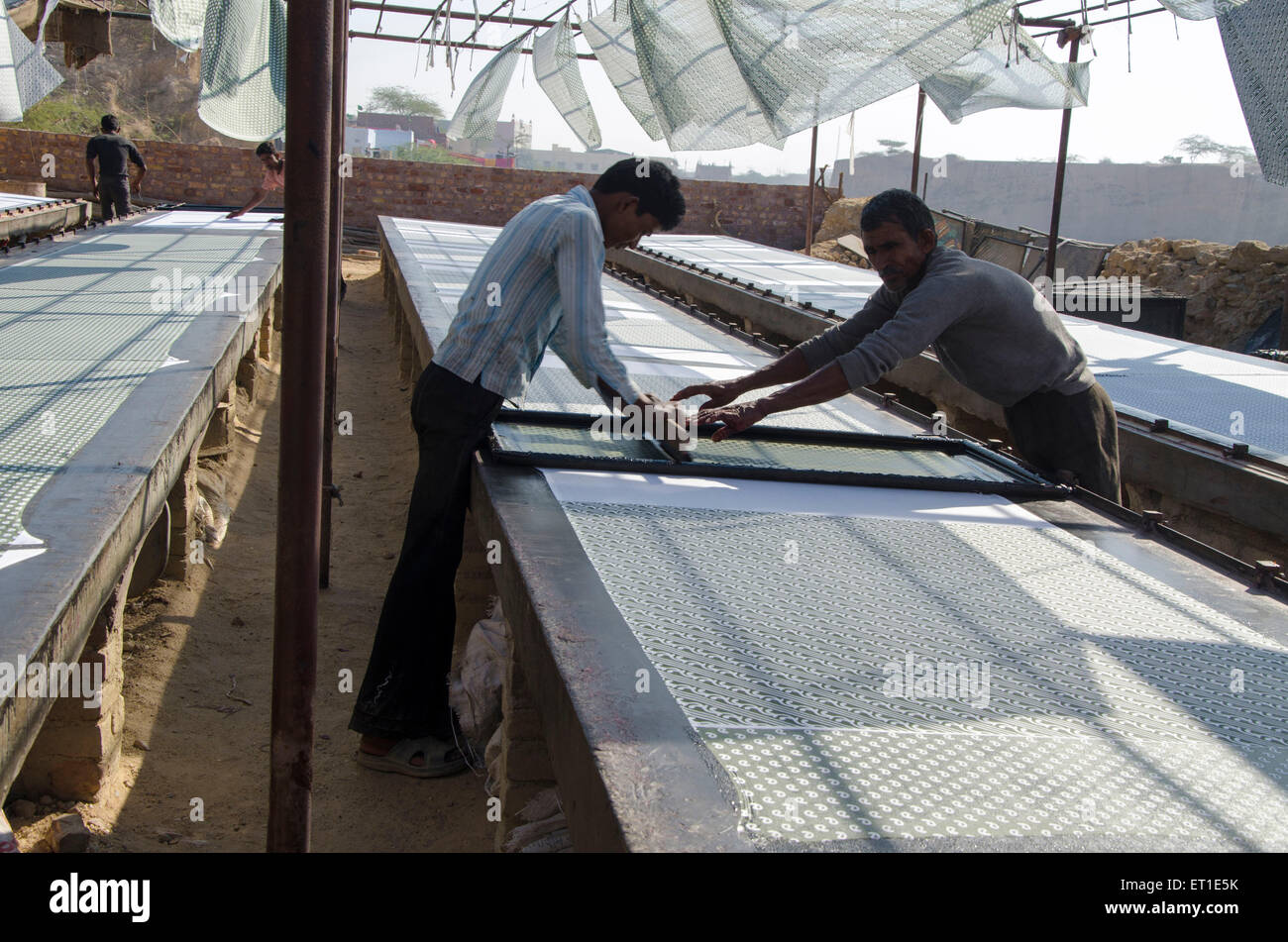 workers engaged in cloth printing work Bikaner Rajasthan India Asia - Stock Image