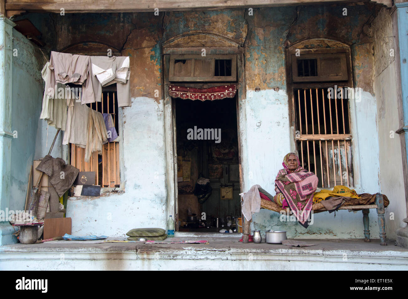 woman sitting in gallery of home Ahmedabad Gujarat India Asia - Stock Image