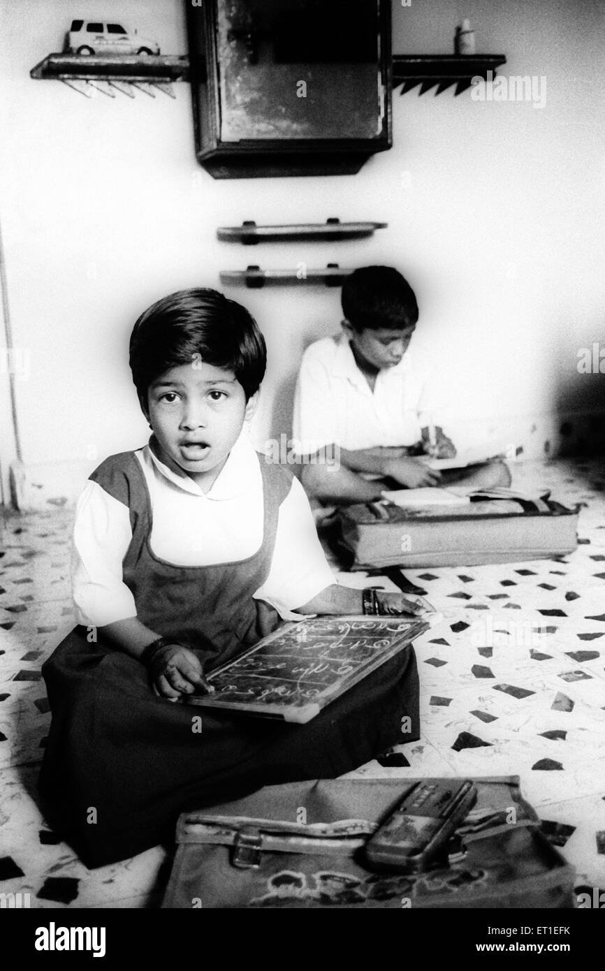 Children of lavani dancers learning to read and write ; India NO MR - Stock Image