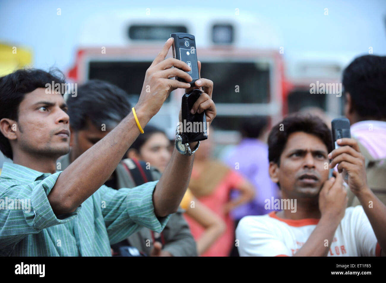 Tourists taking photos on mobile Taj Mahal hotel ; after terrorist attack by Deccan Mujahedeen 26th November 2008 - Stock Image