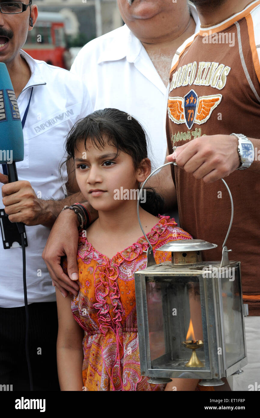 Young girl protesting lamp outside the Taj Mahal hotel ; terrorist attack Deccan Mujahedeen on 26th November 2008 - Stock Image