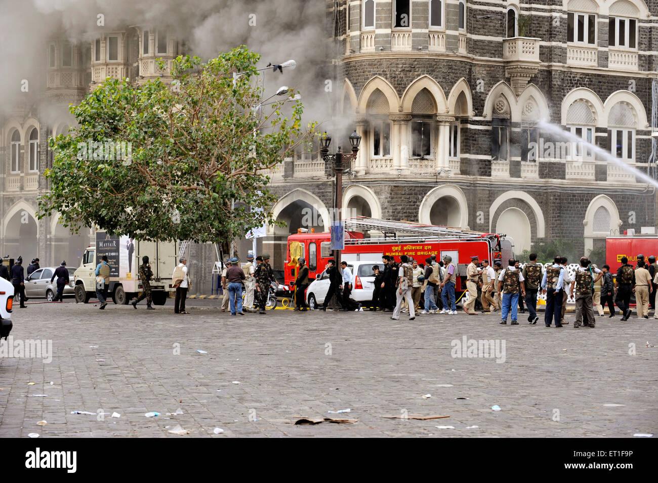 Fire Brigade trying extinguish fire wing Taj Mahal hotel ; after terrorist attack Deccan Mujahedeen 26th November - Stock Image
