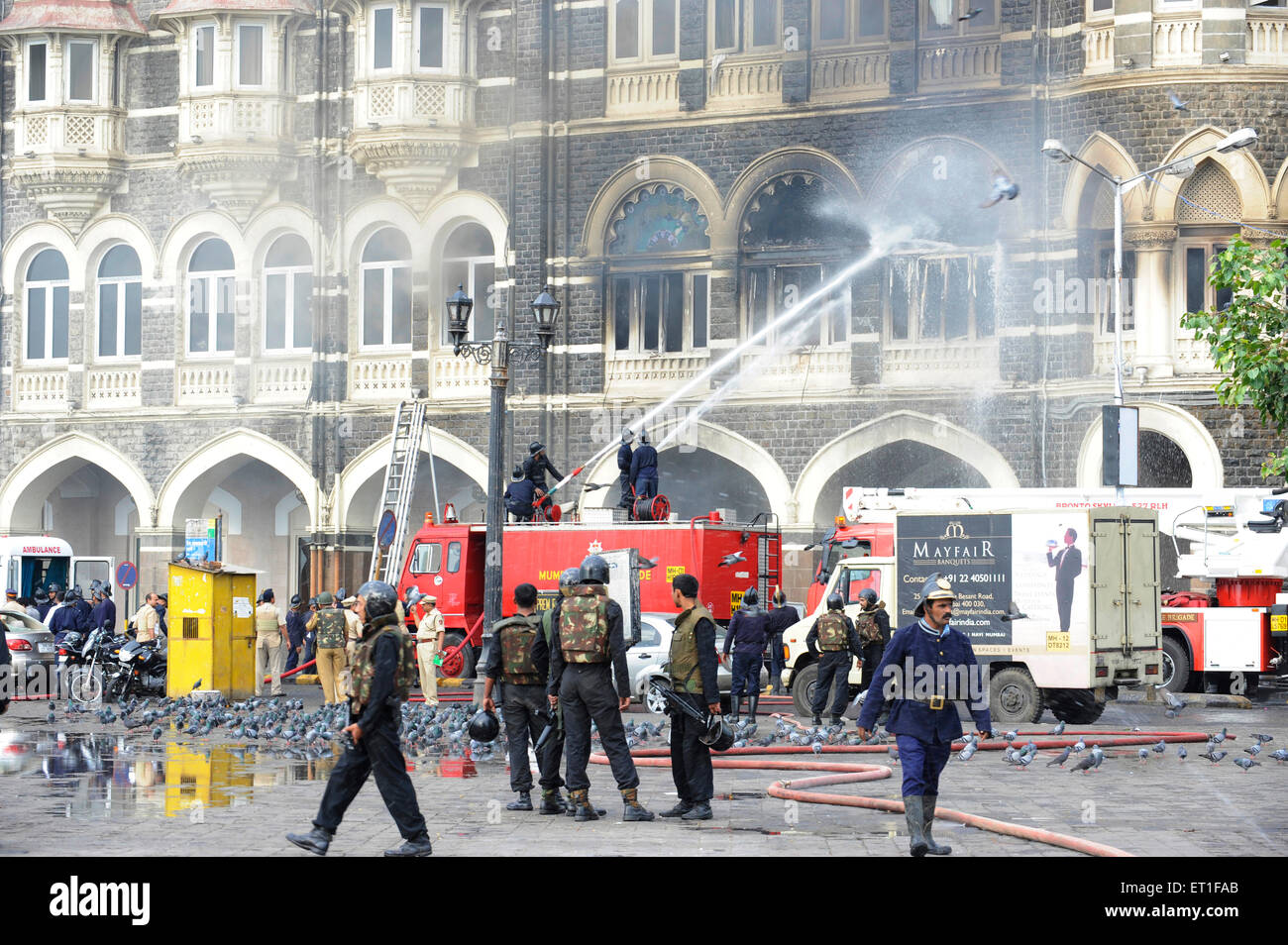 Fire Brigade trying extinguish fire Taj Mahal hotel ; after Terrorist attack by Deccan Mujahedeen on 26 November - Stock Image
