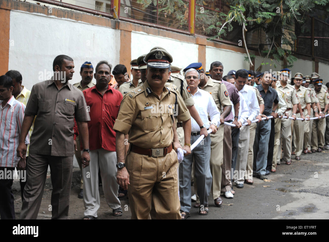 People pulling carriage carrying Chief of Anti Terrorism Squad Hemant Karkare after killed by terrorist attack in Stock Photo
