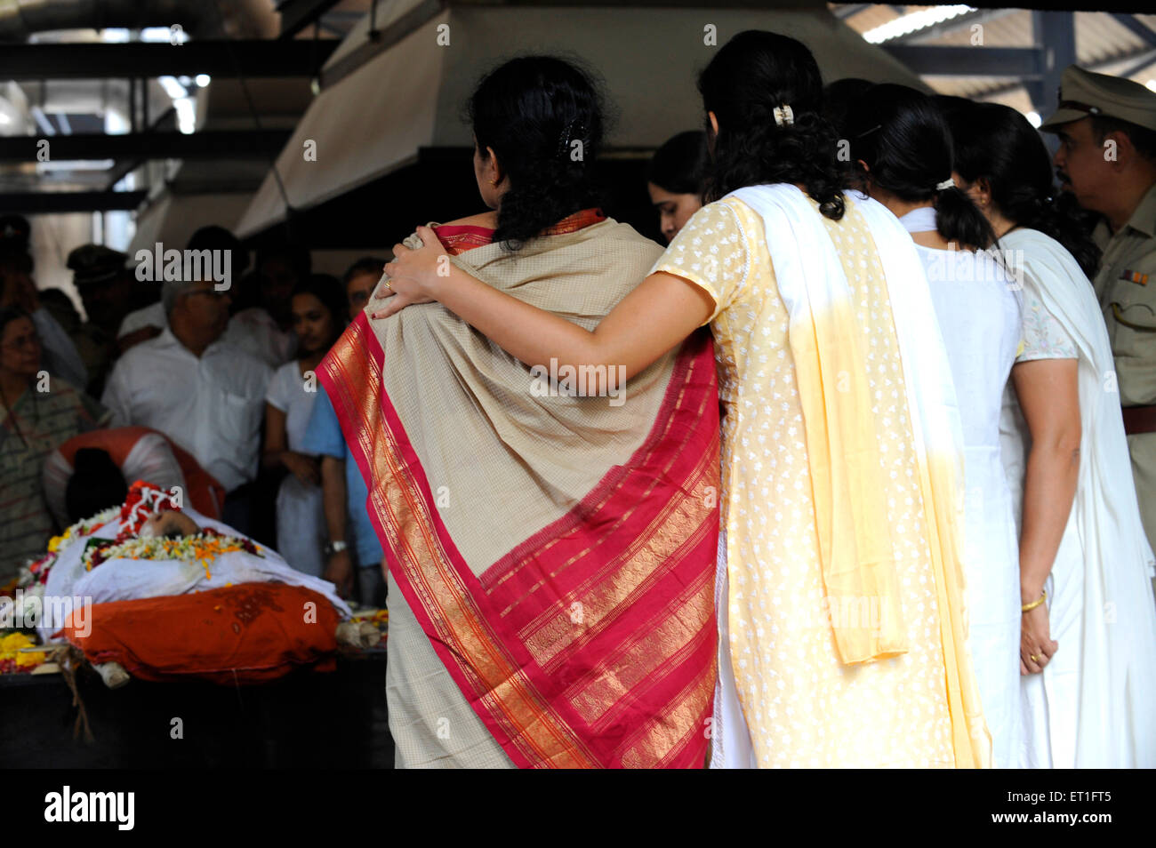 Wife Kavita and daughter Jui at funeral of Anti Terrorism Squad Chief Hemant Karkare killed by terrorist attack Stock Photo