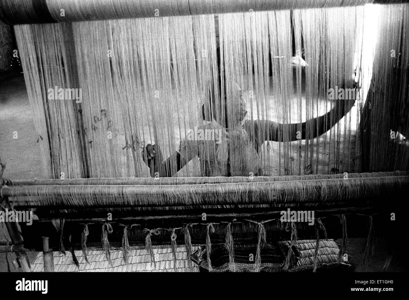 Bodo woman weaving on handloom ; Assam ; India NO MR - Stock Image