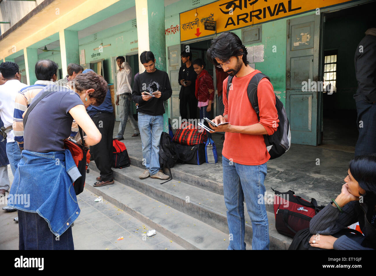 Tourist checking passports at immigration counter at  ; Bangladesh NO MR - Stock Image