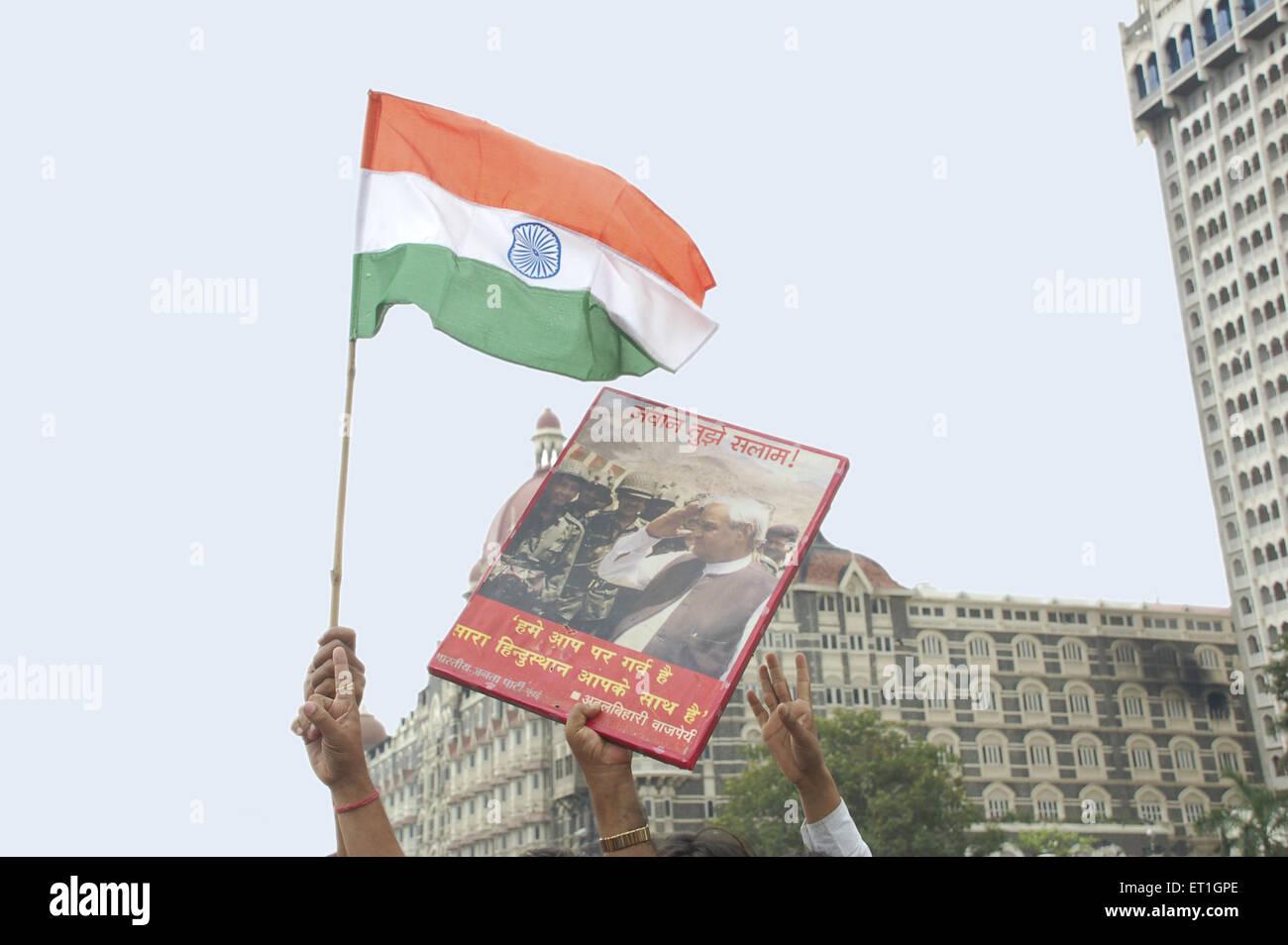 Protestors with banners outside taj mahal hotel after terrorist attack by deccan mujahideen ; Bombay Mumbai ; Maharashtra - Stock Image