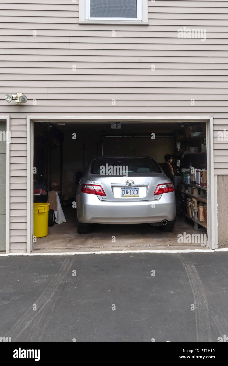 Open Garage Door With Car Parked Inside American Style Wooden House