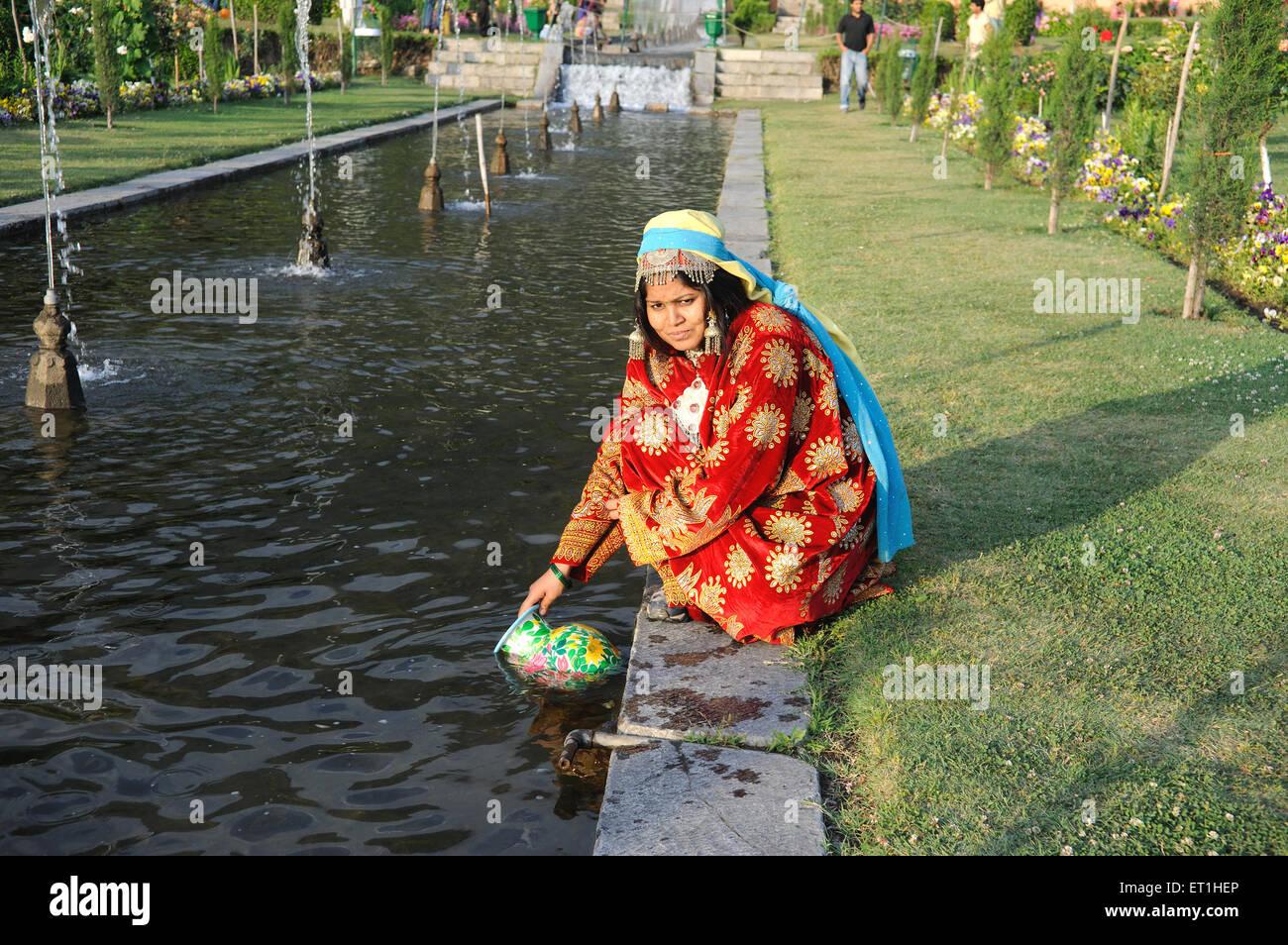 Woman dressed in kashmiri costume ; Gulmarg ; Kashmir ; Jammu and Kashmir ; India MR 400 - Stock Image