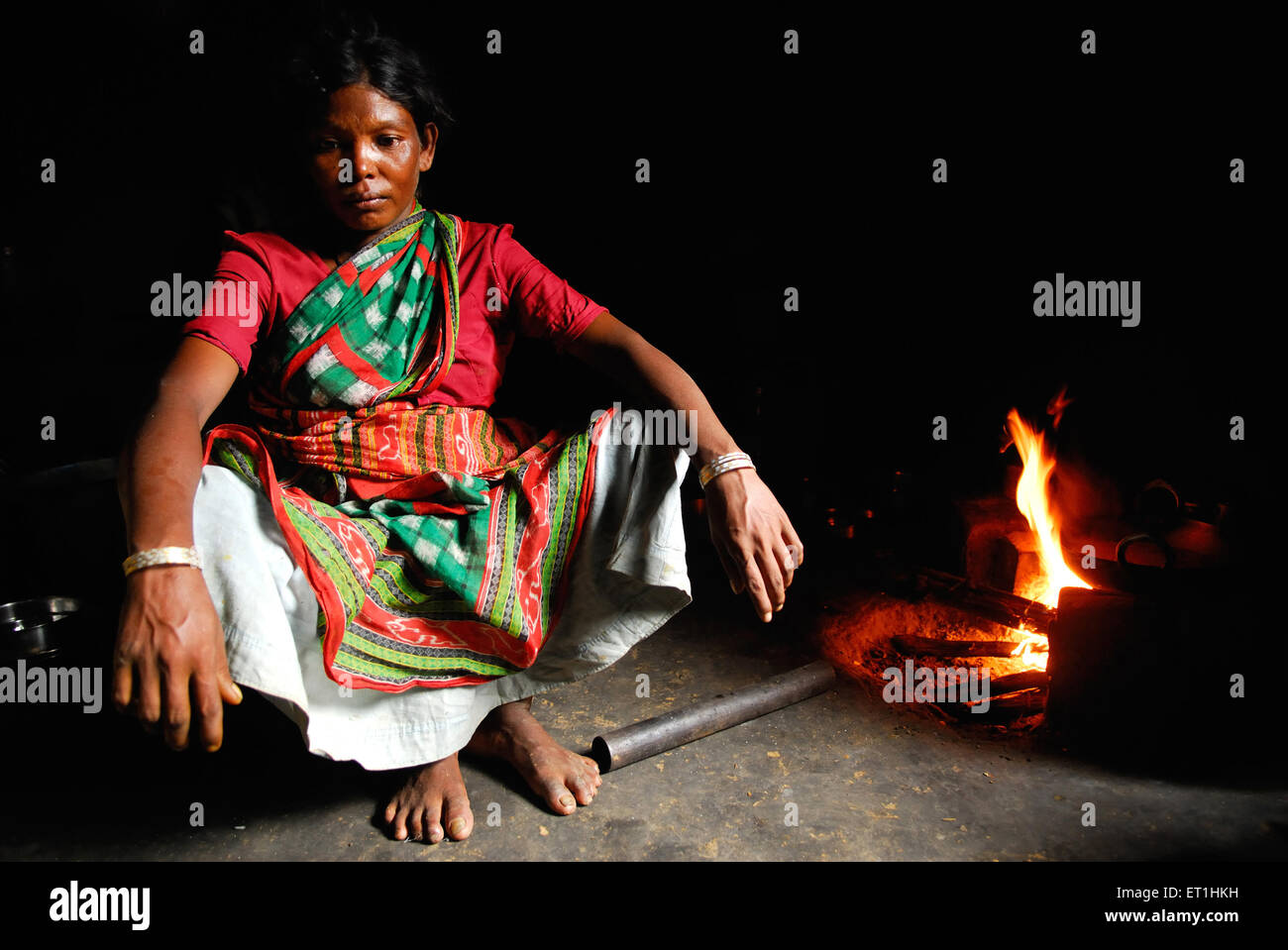 Ho tribes woman cooking with wood coal ; Chakradharpur ;  Jharkhand ; India NO MR - Stock Image
