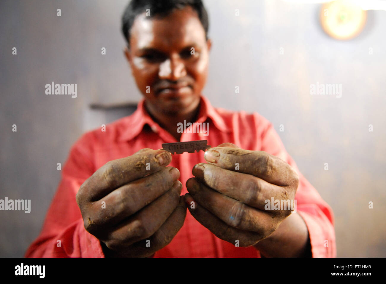 Ho tribes man holding razor ; Chakradharpur ; Jharkhand ; India NO MR - Stock Image