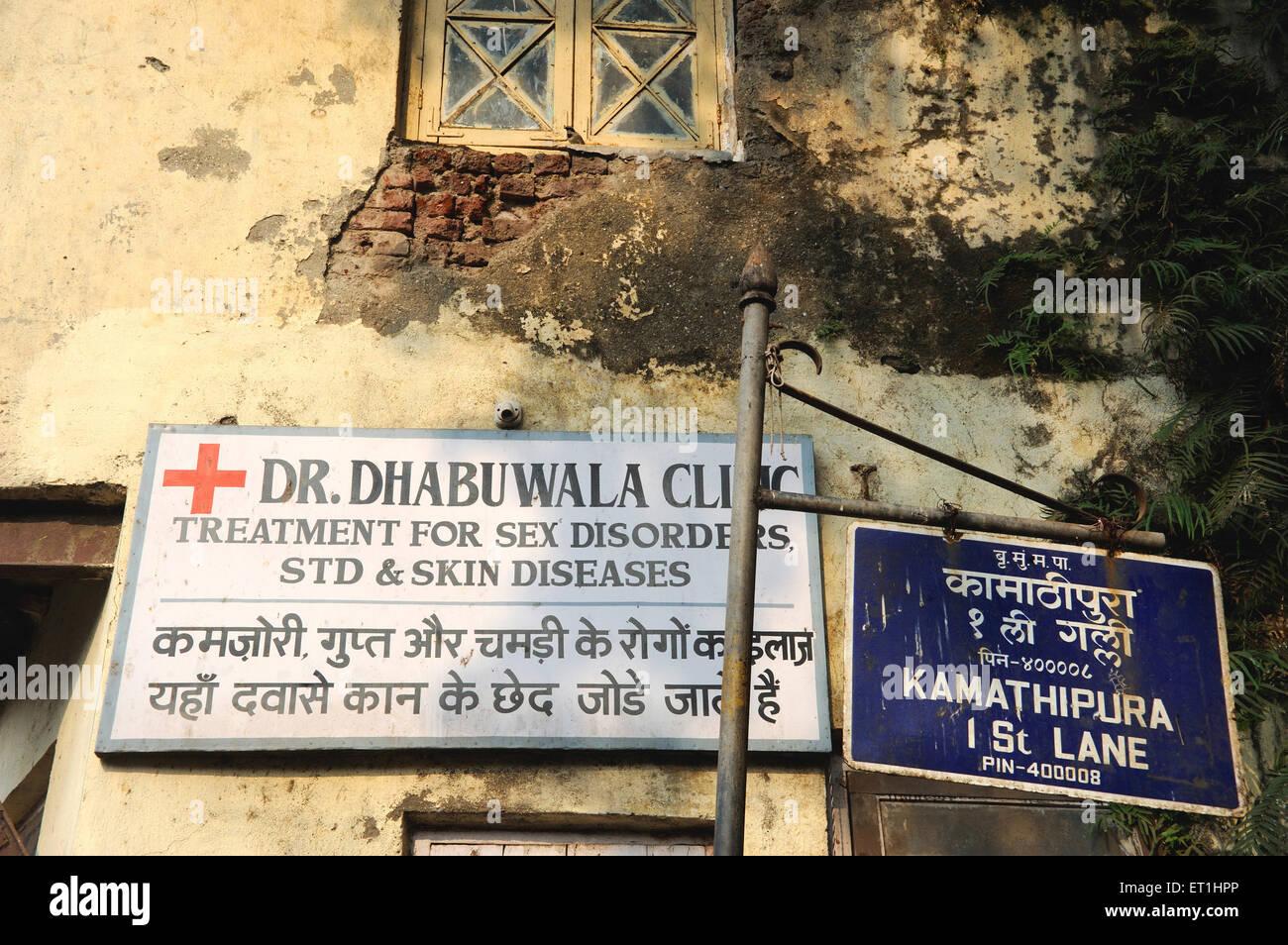 Clinic board in Kamathipura ; Bombay Mumbai ; Maharashtra ; India - Stock Image