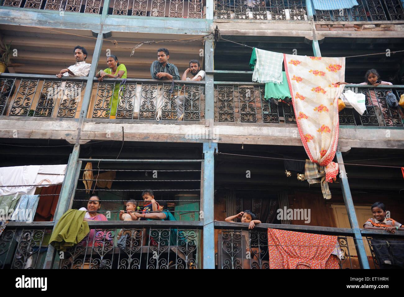 Residents in chawl in Kamathipura ; Bombay Mumbai ; Maharashtra ; India NO MR - Stock Image