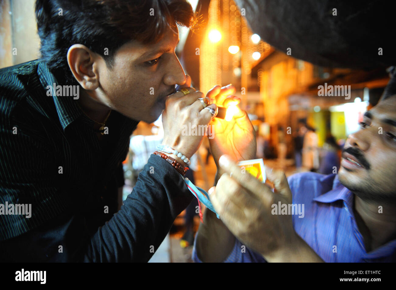 Drug addict taking drug in Kamathipura ; Bombay Mumbai ; Maharashtra ; India NO MR - Stock Image