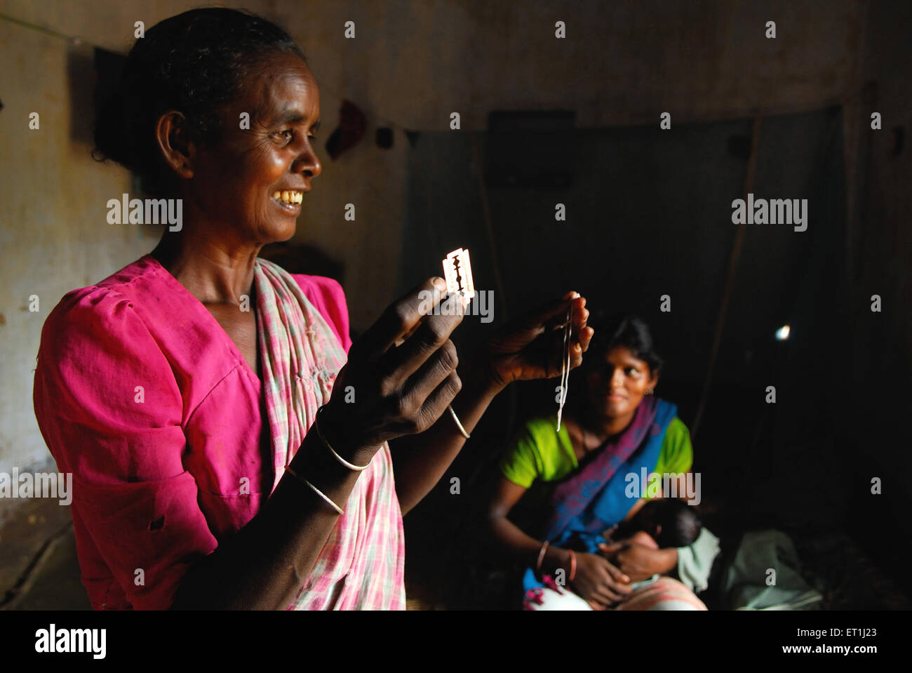 Ho tribes midwife showing thread and razor ; Chakradharpur ; Jharkhand ; India NO MR - Stock Image