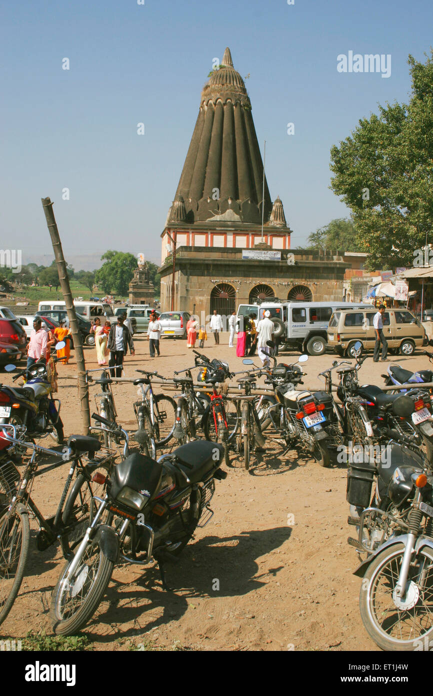 Temple dedicated to lord ganesh named dholu ganpati with bicycles motorcycles and cars in parking lot ; Wai ; Maharashtra - Stock Image