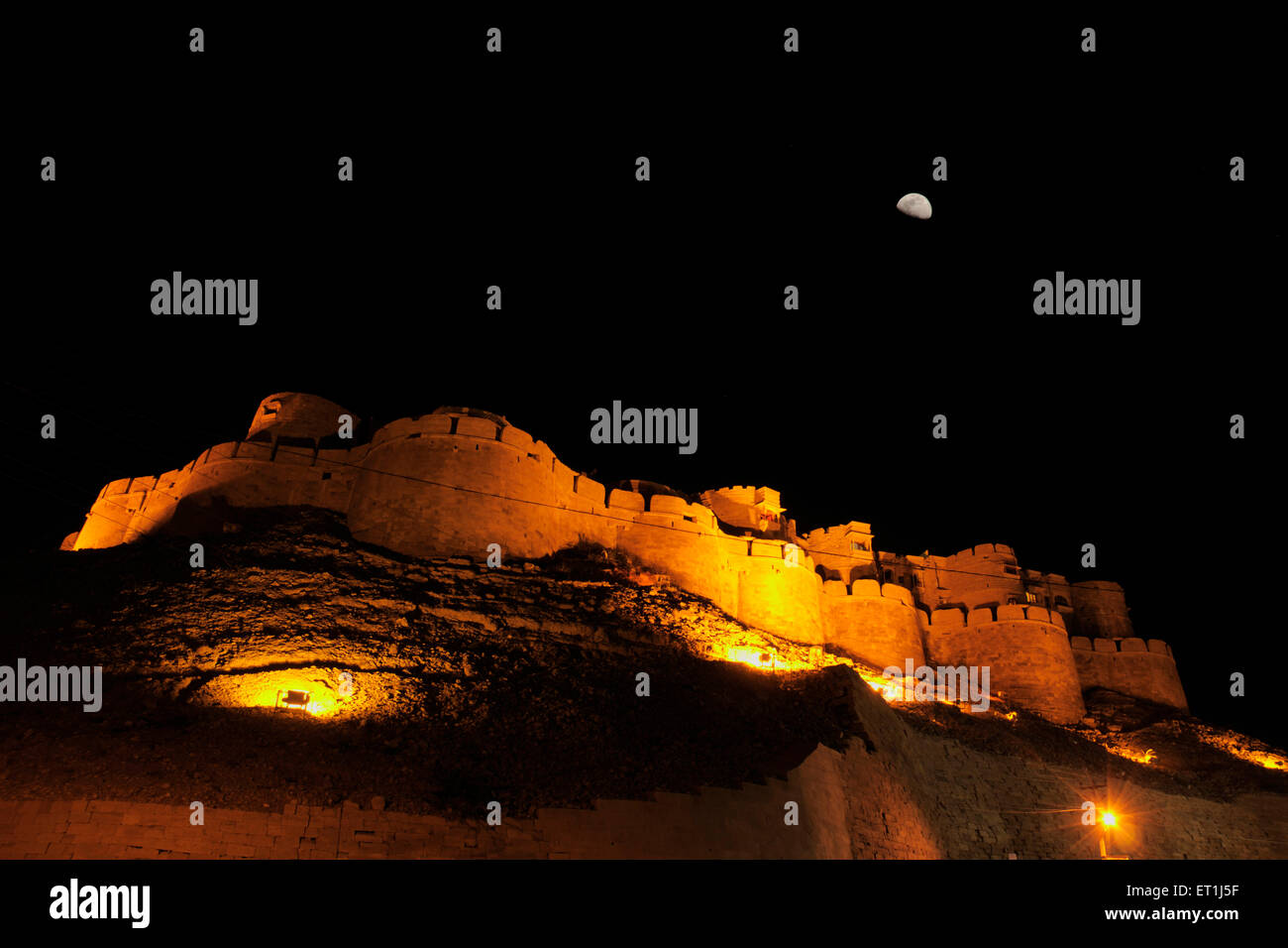 Nightview of half moon above fort of Jaisalmer ; Rajasthan ; India - Stock Image