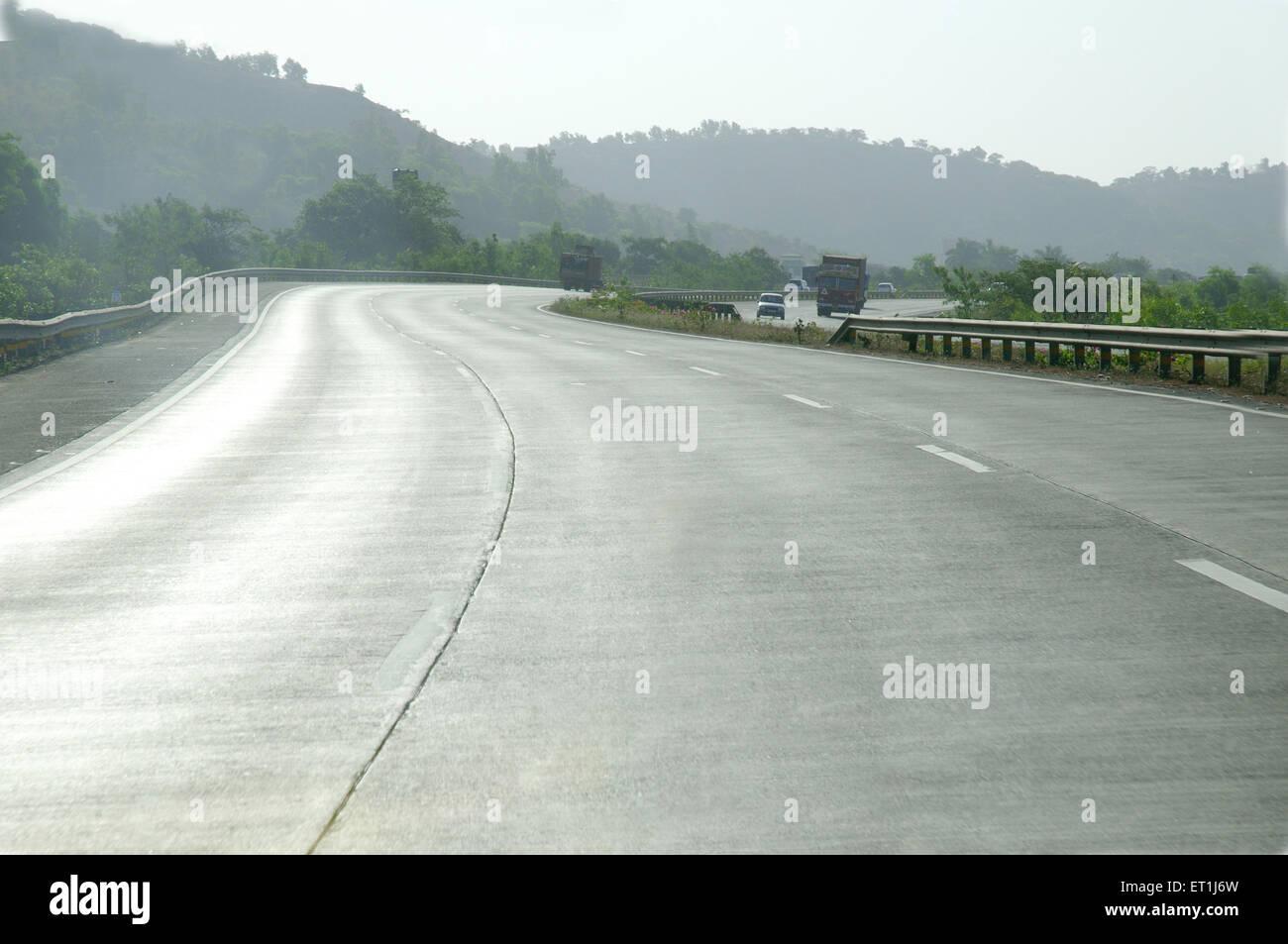 Mumbai Pune expressway with curves ; Maharashtra ; India 3 May 2008 - Stock Image