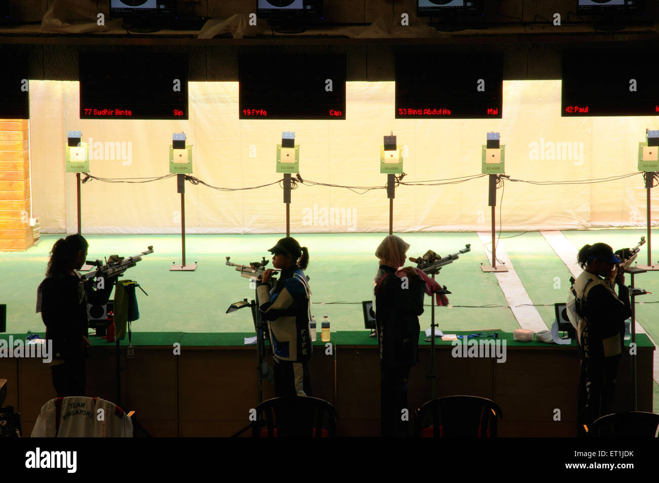 Shooting arena at balewadi stadium with contest of women shooters third commonwealth youth games ; Pune - Stock Image