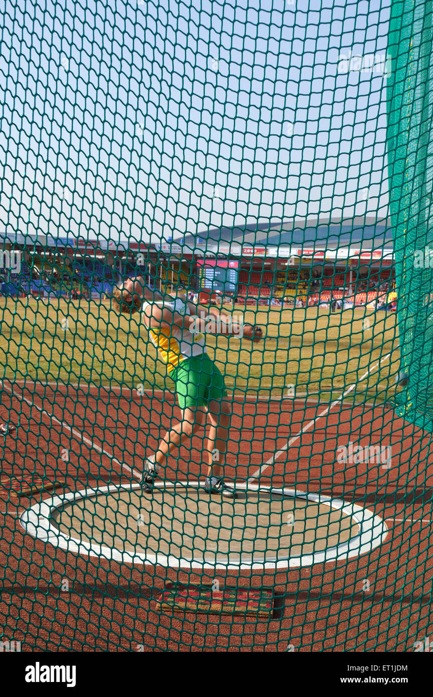 Athlete attempting hammer throw in third commonwealth youth games ; Pune ; Maharashtra India - Stock Image