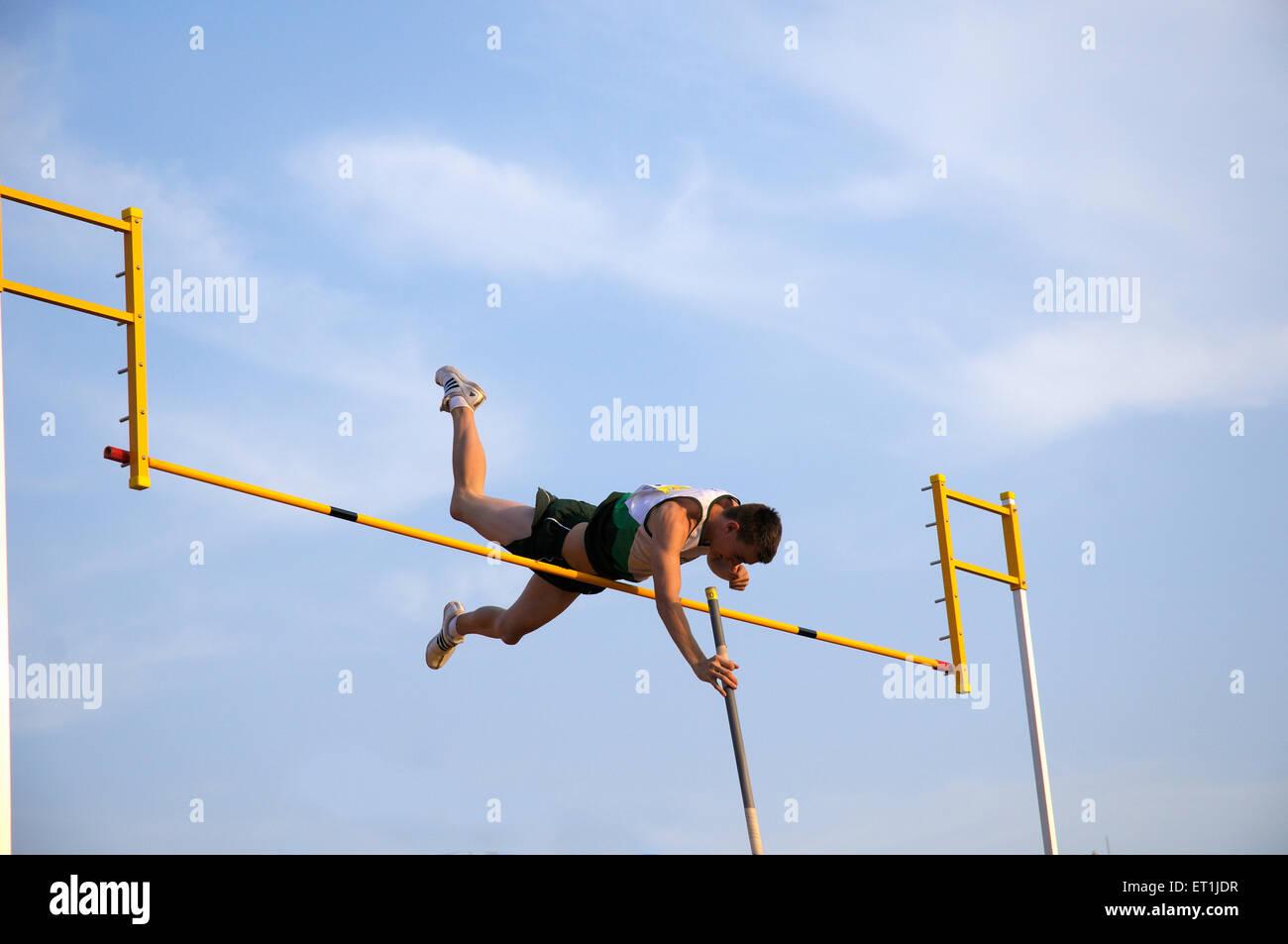 Athlete attempting pole vault jump ; Pune ; Maharashtra ; India 15 October 2008 NOMR - Stock Image