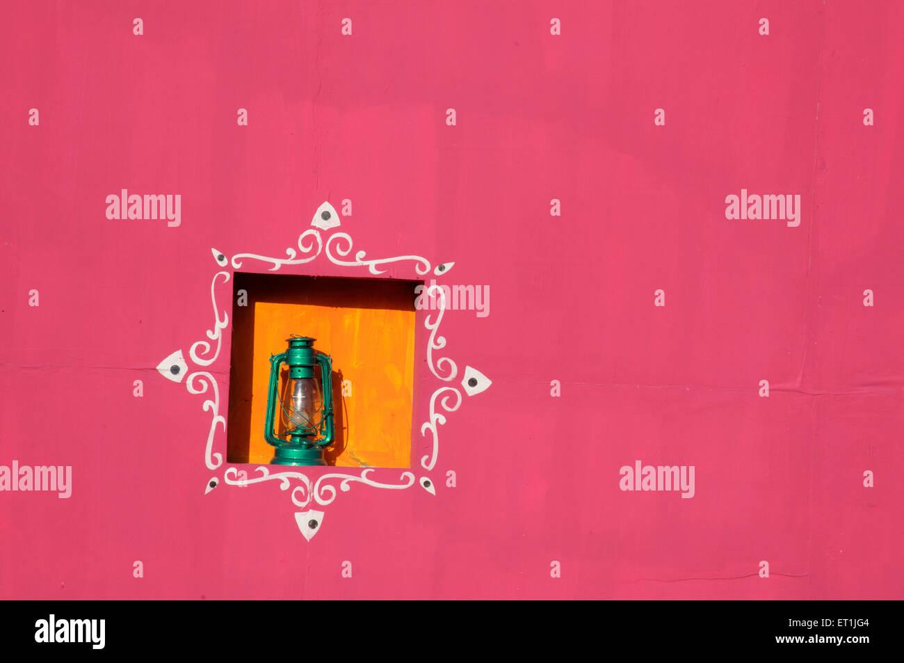 Painted wall and window with lantern ; Pune ; Maharashtra ; India 15 October 2008 - Stock Image
