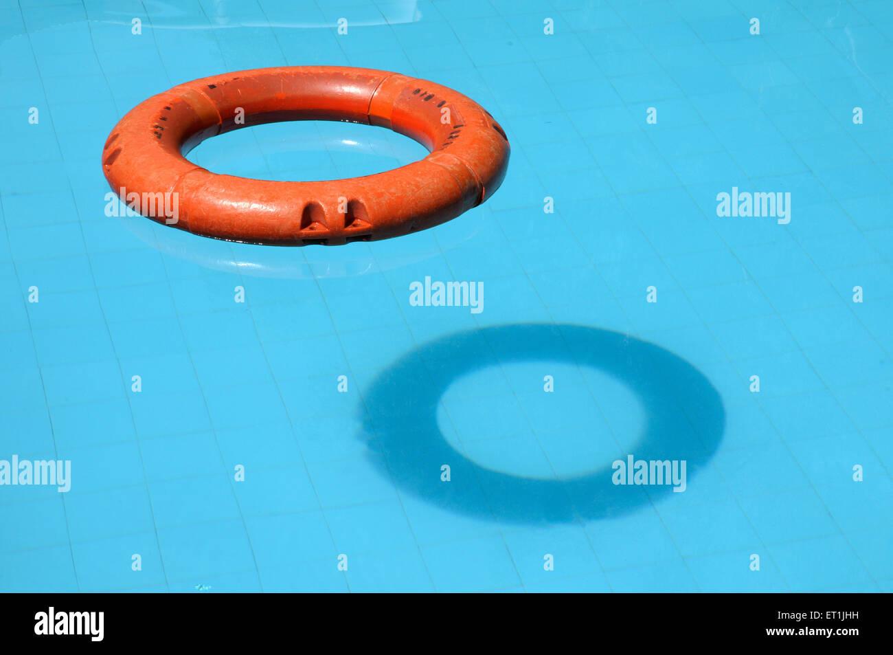 Rescue equipment lifeguard ring buoy floating on swimming pool in surya shibir ; Pune ; Maharashtra ; India 12 July - Stock Image