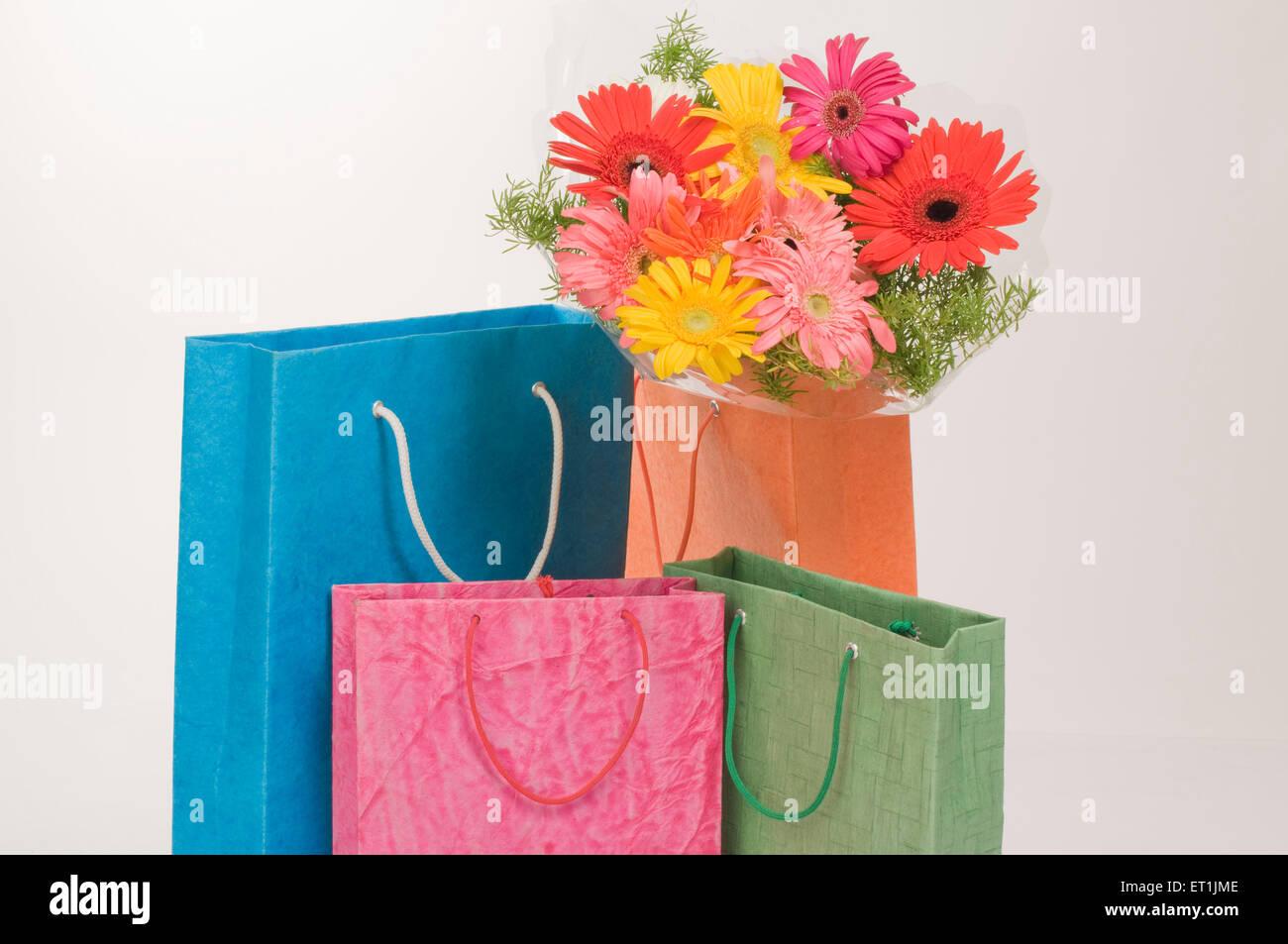 Shopping bags with flower bouquet Pune Maharashtra India Asia  June 2011 - Stock Image