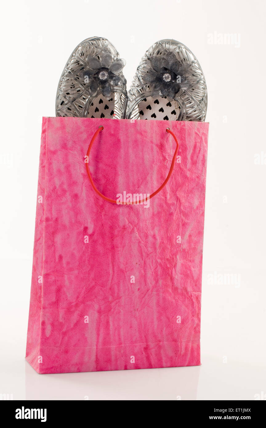 Fancy shoes in shopping bag Pune Maharashtra India Asia June 2011 - Stock Image