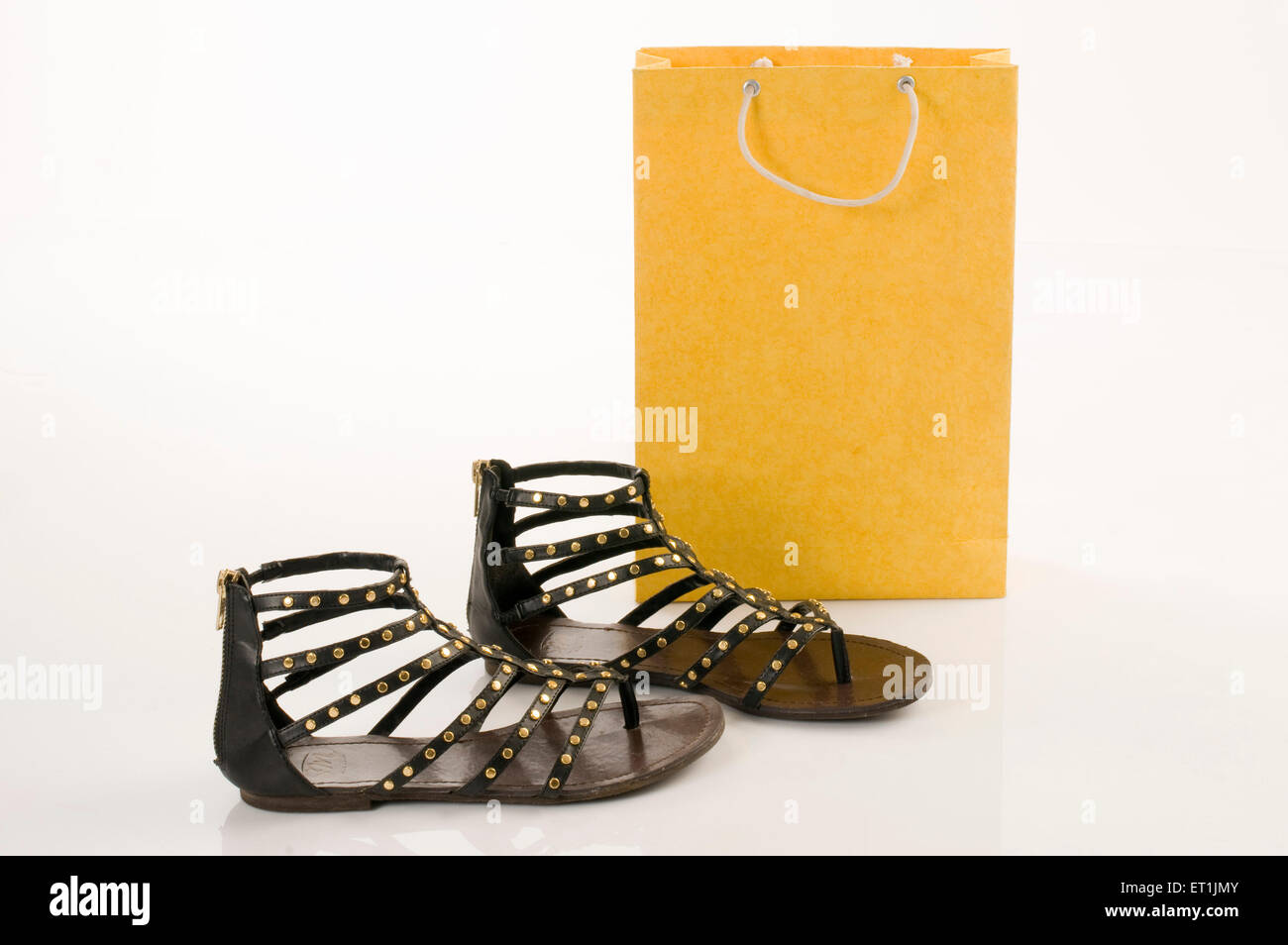 Shopping bag with fancy leather sandal Pune Maharashtra India Asia June 2011 - Stock Image