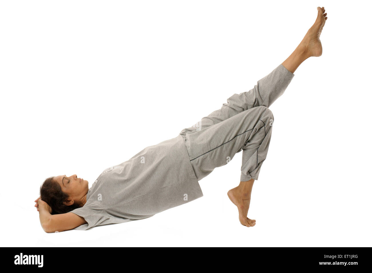 Lady doing yogic exercises ardha chakra asana  MR#190 5 September 2009 - Stock Image