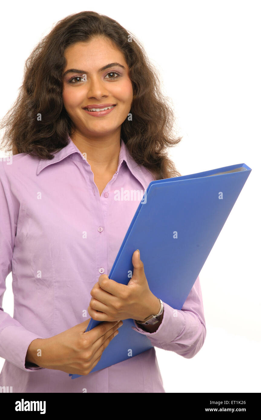 Woman holding blue file MR#686M 20 March 2010 - Stock Image