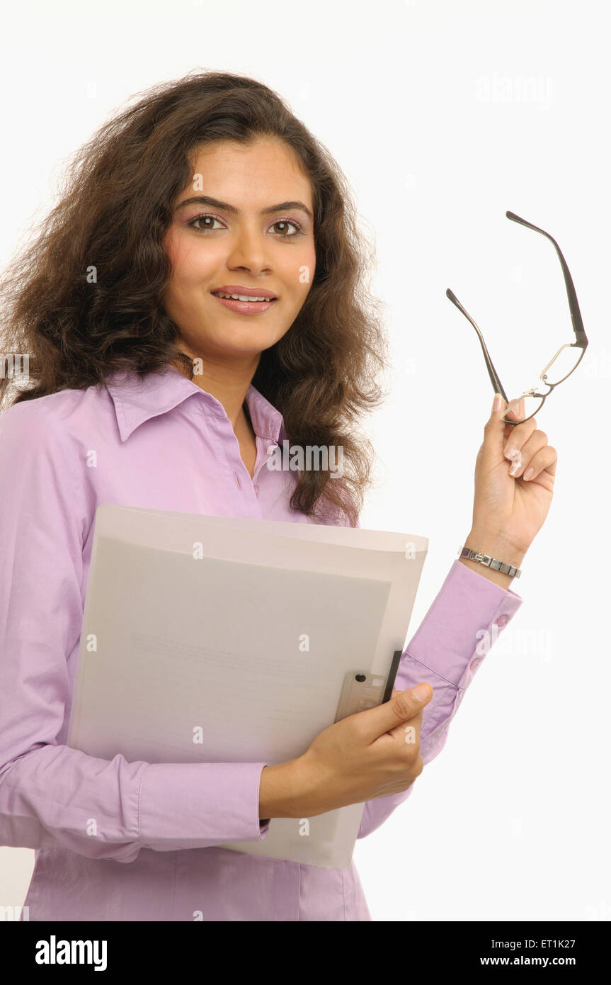 Woman with spectacles and white file MR#686M 20 March 2010 - Stock Image