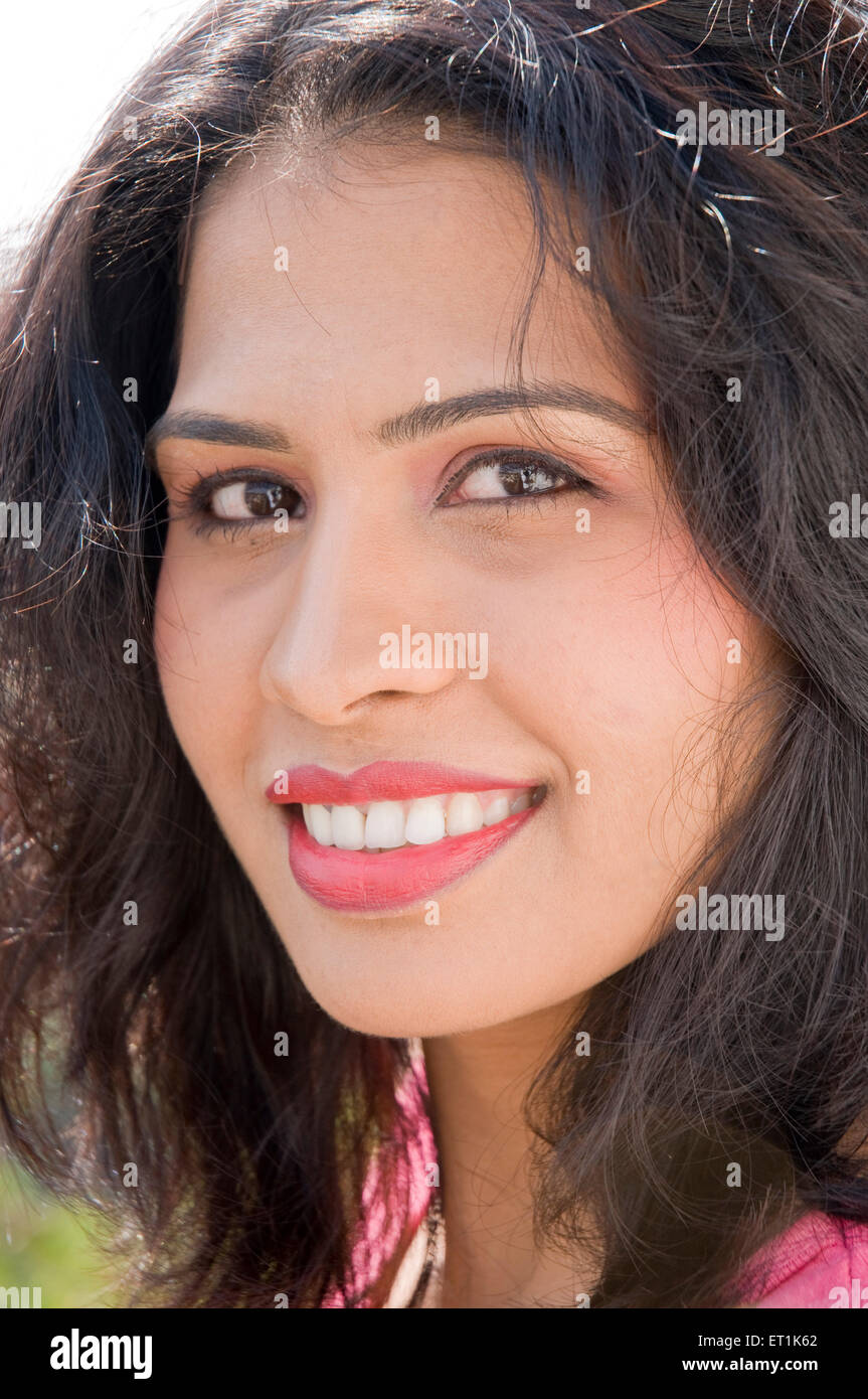 Lady Smiling with Tousled hair Pune Maharashtra India Asia Jan 2011MR#686 W - Stock Image
