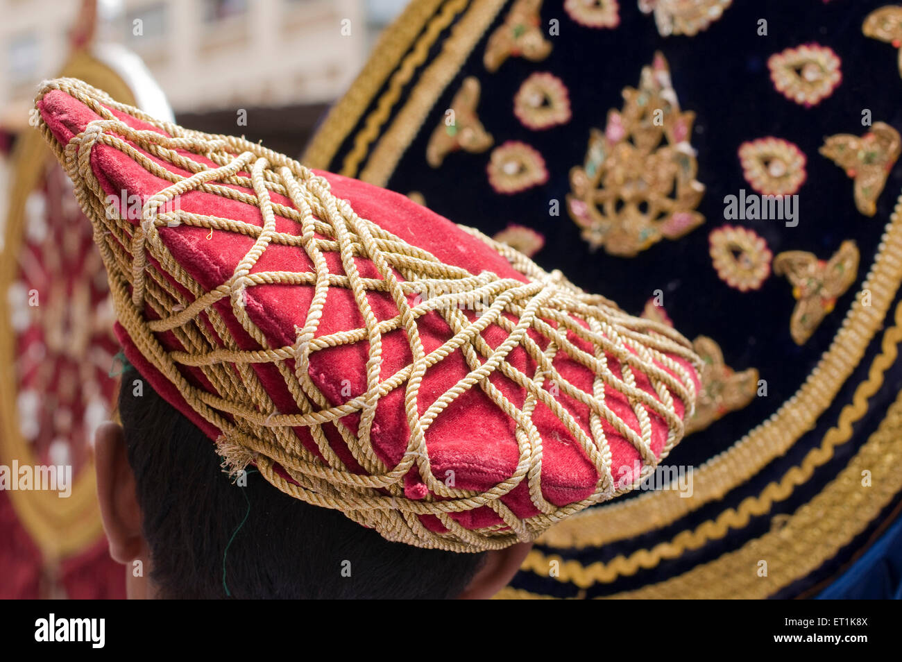 Red and golden stringed headgear Pune Maharashtra India Asia Sept 2011 - Stock Image