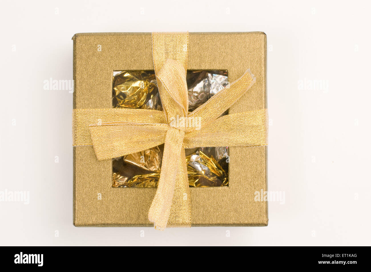 Golden cardboard box Pune Maharashtra India Asia Oct 2011 - Stock Image