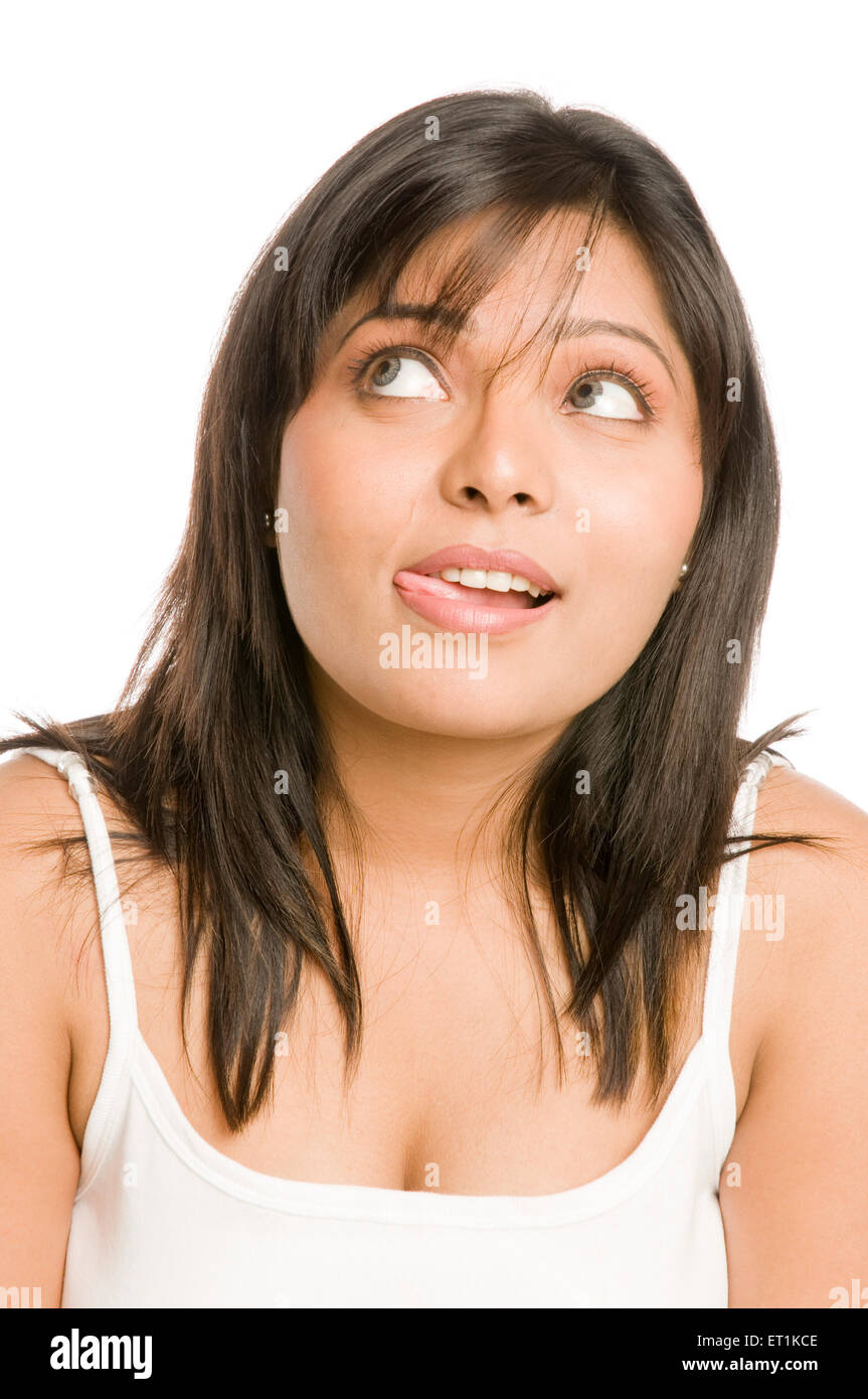 Girl Giving Memory Recollection Expression Pune Maharashtra India Asia Feb 2011 MR#686 X - Stock Image