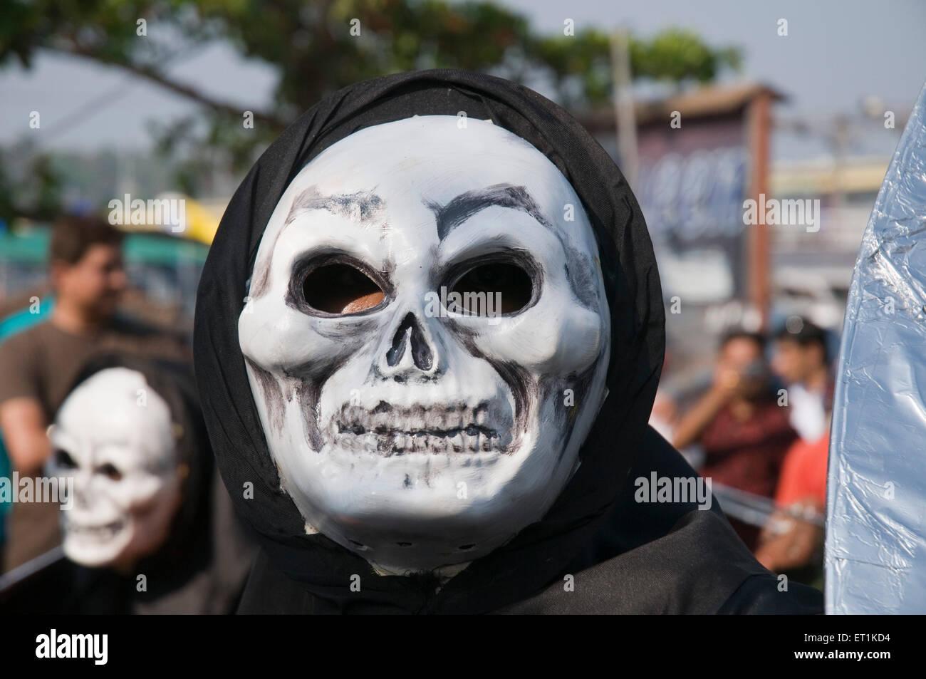 White skeleton masks and black robes Goa Maharashtra India Asia March 2011 - Stock Image