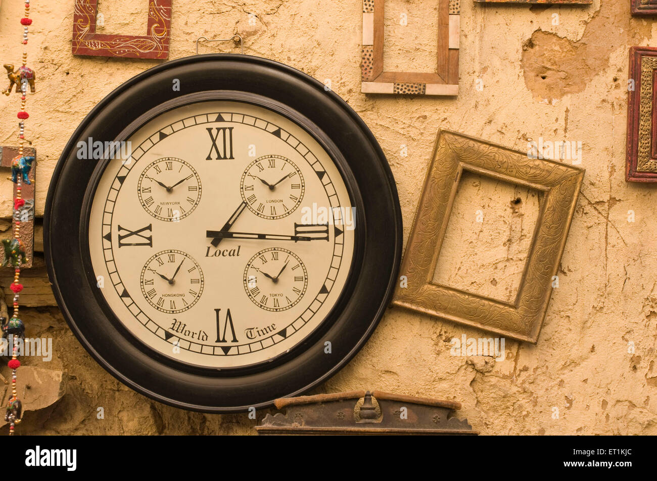 antique wooden wall clock for sale Jaisalmer Rajasthan India Asia - Stock Image