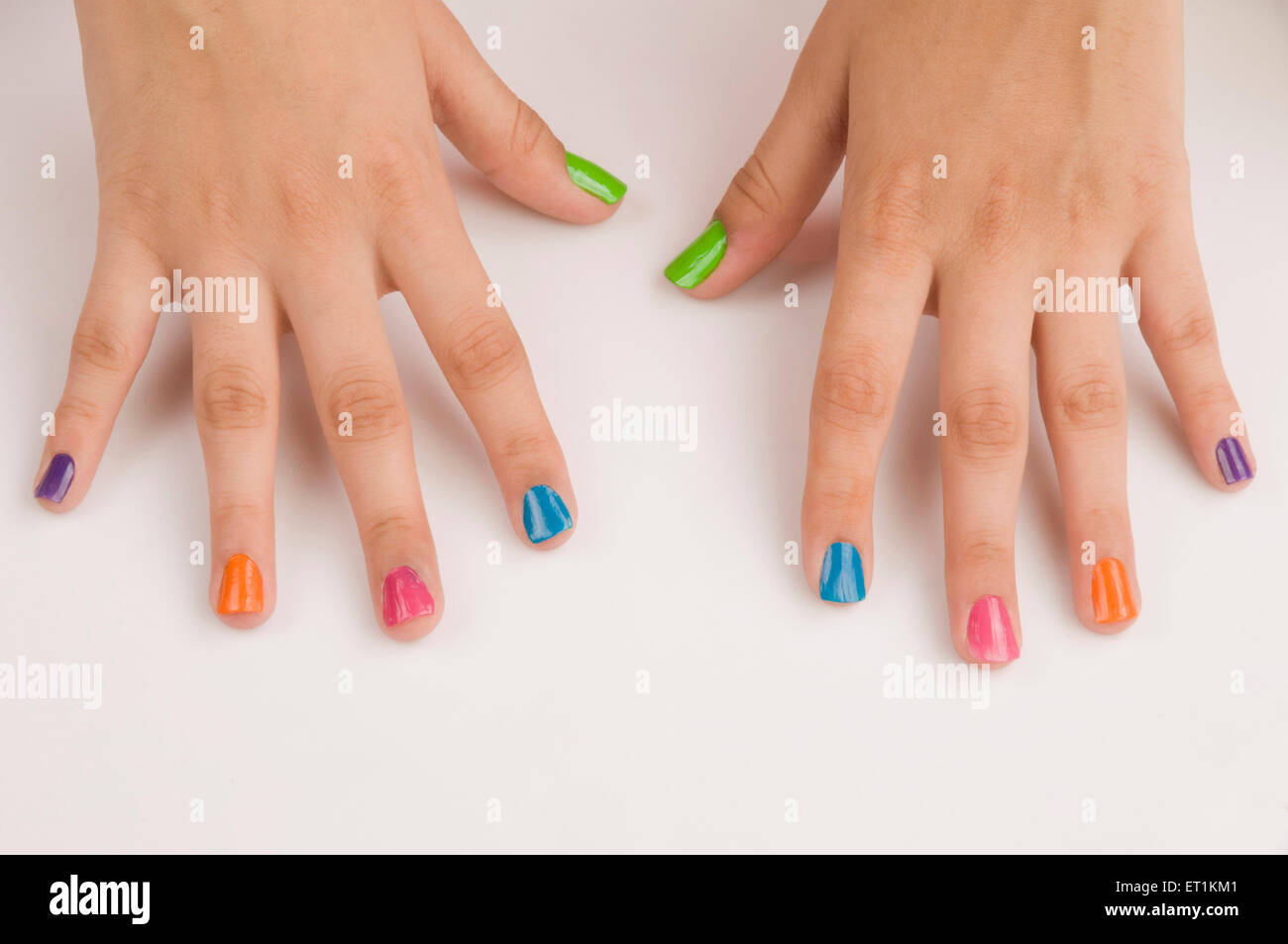 Different colours of nail polish on nails Pune Maharashtra India Asia May 2011 - Stock Image